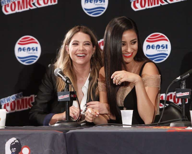 "PRETTY LITTLE LIARS - Lucy Hale, Shay Mitchell, Ashley Benson, Troian Bellisario and Sasha Pieterse as well as Executive producers Marlene King, Oliver Goldstick and Joseph Dougherty assemble at Comic-Con New York to preview the new mystery facing the girls when ""Pretty Little Liars"" returns in January 2016. (ABC Family/Lou Rocco) ASHLEY BENSON, SHAY MITCHELL"