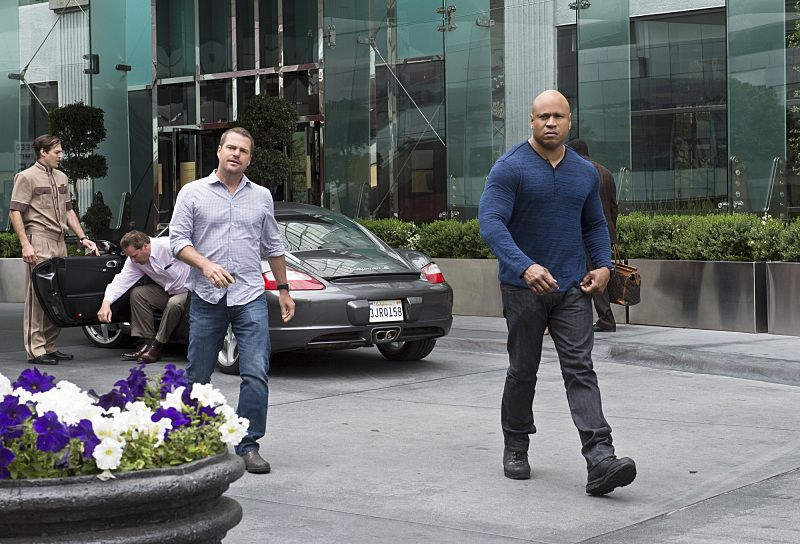 """""""Blame It On Rio"""" -- Pictured: Chris O'Donnell (Special Agent G. Callen) and LL COOL J (Special Agent Sam Hanna). NCIS Special Agent DiNozzo (Michael Weatherly) partners with the NCIS: Los Angeles team to search the city after his prisoner escapes custody on a flight from Singapore to Los Angeles, on NCIS: LOS ANGELES, Monday, Oct. 19 (9:59-11:00 PM, ET/PT), on the CBS Television Network. Photo: Neil Jacobs/CBS ©2015 CBS Broadcasting, Inc. All Rights Reserved."""