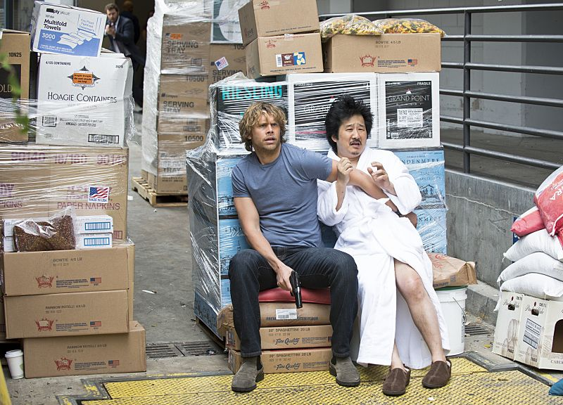 """""""Blame It On Rio"""" -- Pictured: Eric Christian Olsen (LAPD Liaison Marty Deeks) and Bobby Lee (Rio Syamsundin). NCIS Special Agent DiNozzo (Michael Weatherly) partners with the NCIS: Los Angeles team to search the city after his prisoner escapes custody on a flight from Singapore to Los Angeles, on NCIS: LOS ANGELES, Monday, Oct. 19 (9:59-11:00 PM, ET/PT), on the CBS Television Network. Photo: Neil Jacobs/CBS ©2015 CBS Broadcasting, Inc. All Rights Reserved."""