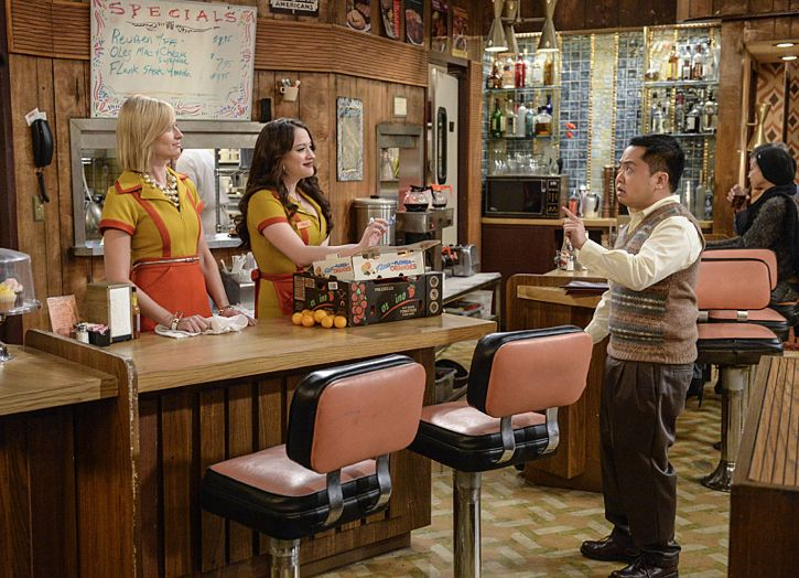 """And The Story Telling Show"" -- Pictured (L-R): Caroline Channing (Beth Behrs), Max Black (Kat Dennings) and Han Lee (Matthew Moy). Caroline shares her riches-to-rags life story on stage at a storytelling night and captures the attention of a Hollywood studio executive. Meanwhile, Sophie and Oleg search for a surrogate, when 2 BROKE GIRLS moves to its new day and time, Thursday, Feb. 18 (9:30-10:00 PM, ET/PT) on the CBS Television Network. Photo: Darren Michaels/Warner Bros. Entertainment Inc. © 2016 WBEI. All rights reserved."