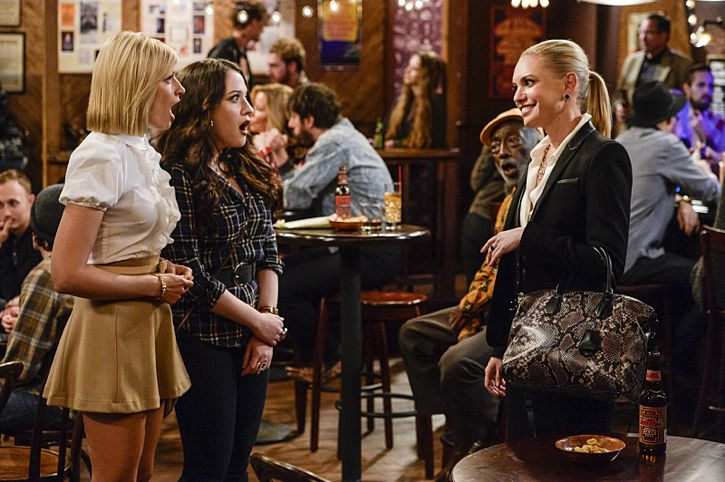 """And The Story Telling Show"" -- Pictured (L-R): Caroline Channing (Beth Behrs), Max Black (Kat Dennings) and Nina (Barret Swatek). Caroline shares her riches-to-rags life story on stage at a storytelling night and captures the attention of a Hollywood studio executive. Meanwhile, Sophie and Oleg search for a surrogate, when 2 BROKE GIRLS moves to its new day and time, Thursday, Feb. 18 (9:30-10:00 PM, ET/PT) on the CBS Television Network. Photo: Darren Michaels/Warner Bros. Entertainment Inc. © 2016 WBEI. All rights reserved."