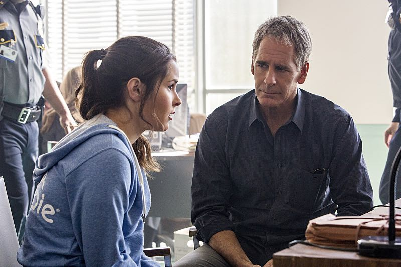 """""""Means to an End"""" -- The NCIS team discovers a surveillance van filled with photos documenting Special Agent Pride's every move after his daughter Laurel is attacked on campus and placed in protective custody, on NCIS: NEW ORLEANS, Tuesday, March 22 (9:00-10:00 PM, ET/PT), on the CBS Television Network. Pictured L-R: Shanley Caswell as Laurel and Scott Bakula as Special Agent Dwayne Pride Photo: Skip Bolen/CBS ©2016 CBS Broadcasting, Inc. All Rights Reserved"""
