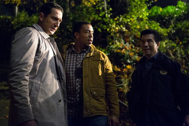 "GRIMM -- ""Into The Schwarzwald"" Episode 512 -- Pictured: (l-r) Sasha Roiz as Captain Renard, Russell Hornsby as Hank Griffin, Reggie Lee as Sergeant Wu -- (Photo by: Scott Green/NBC)"