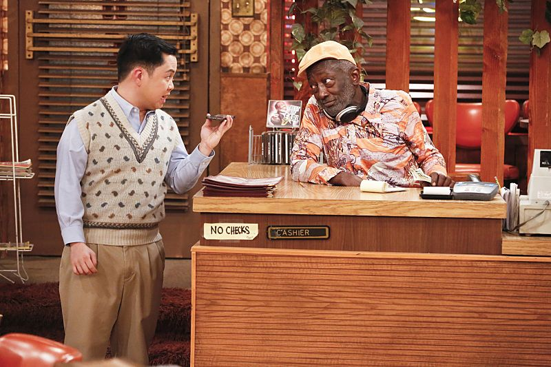 """And the Great Escape"" -- Pictured: Han Lee (Matthew Moy) and Earl (Garrett Morris). As Max pet sits Randy's dog, Bruno, at his Hollywood Hills home, and Caroline sets up meetings with actresses who are interested in playing her in the potential biopic, Bruno escapes while a cannibalistic serial killer is loose in their neighborhood, on 2 BROKE GIRLS, Thursday, March 10 (9:30-10:00 PM, ET/PT) on the CBS Television Network. Photo: Robert Voets/CBS ©2016 CBS Broadcasting, Inc. All Rights Reserved."