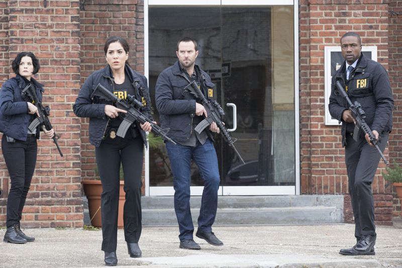 "BLINDSPOT -- ""Scientists Hollow Fortune"" Episode 112 -- Pictured: (l-r) Jaimie Alexander as Jane Doe, Audrey Esparza as Zapata, Sullivan Stapleton as Kurt Weller, Rob Brown as Reade -- (Photo by: {Paul Sarkis/NBC)"