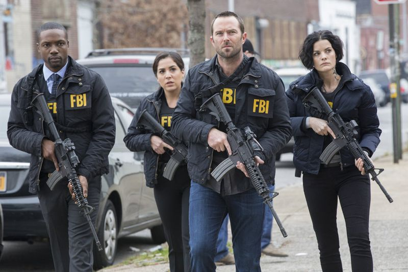 "BLINDSPOT -- ""Scientists Hollow Fortune"" Episode 112 -- Pictured: (l-r) Rob Brown as Reade, Audrey Esparza as Zapata, Sullivan Stapleton as Kurt Weller, Jaimie Alexander as Jane Doe -- (Photo by: {Paul Sarkis/NBC)"