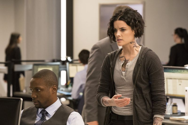 "BLINDSPOT -- ""Scientists Hollow Fortune"" Episode 112 -- Pictured: (l-r) Rob Brown as Reade, Jaimie Alexander as Jane Doe -- (Photo by: {Paul Sarkis/NBC)"