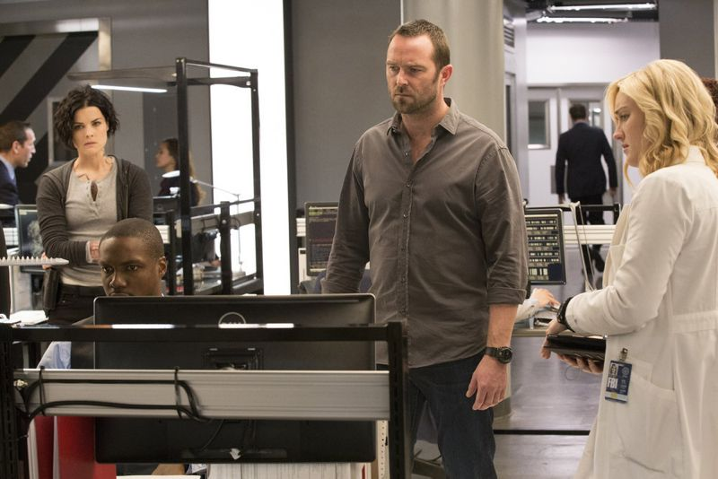 "BLINDSPOT -- ""Scientists Hollow Fortune"" Episode 112 -- Pictured: (l-r) Jaimie Alexander as Jane Doe, Rob Brown as Reade, Sullivan Stapleton as Kurt Weller, Ashley Johnson as Patterson -- (Photo by: {Paul Sarkis/NBC)"