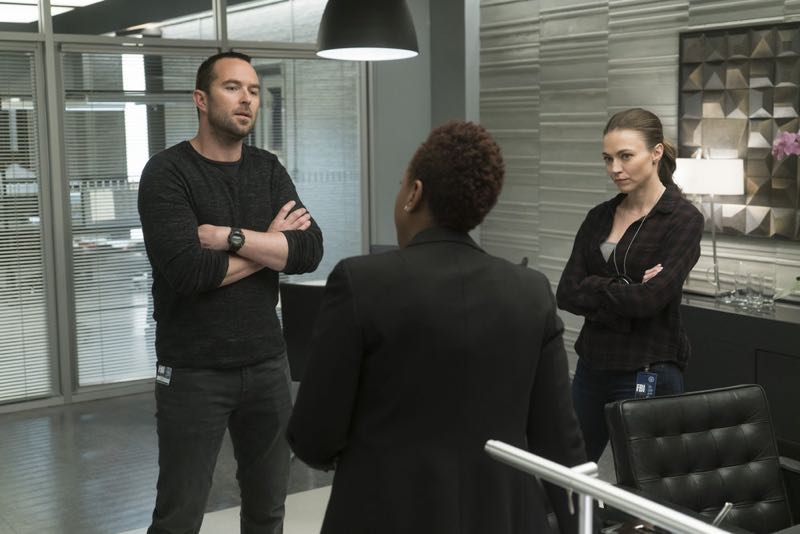 "BLINDSPOT -- ""One Begets Technique"" Episode 118 -- Pictured: (l-r) Sullivan Stapleton as Kurt Weller, Marianne Jean-Baptiste as Bethany Mayfair, Trieste Kelly Dunn as Allison Knight -- (Photo by: Peter Kramer/NBC)"