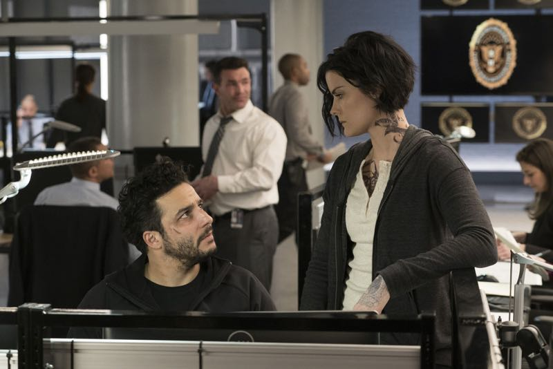 "BLINDSPOT -- ""One Begets Technique"" Episode 118 -- Pictured: (l-r) Ennis Esmer as Rich Dotcom, Jaimie Alexander as Jane Doe -- (Photo by: Peter Kramer/NBC)"
