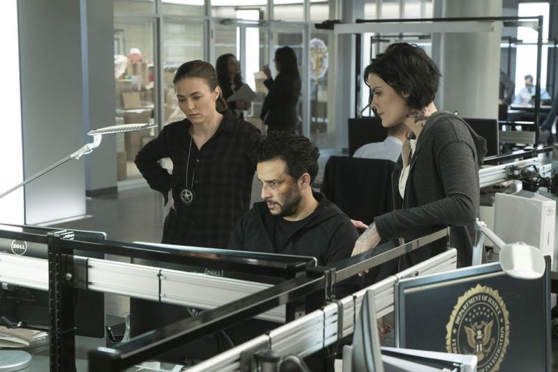 "BLINDSPOT -- ""One Begets Technique"" Episode 118 -- Pictured: (l-r) Trieste Kelly Dunn as Allison Knight, Ennis Esmer as Rich Dotcom, Jaimie Alexander as Jane Doe -- (Photo by: Peter Kramer/NBC)"