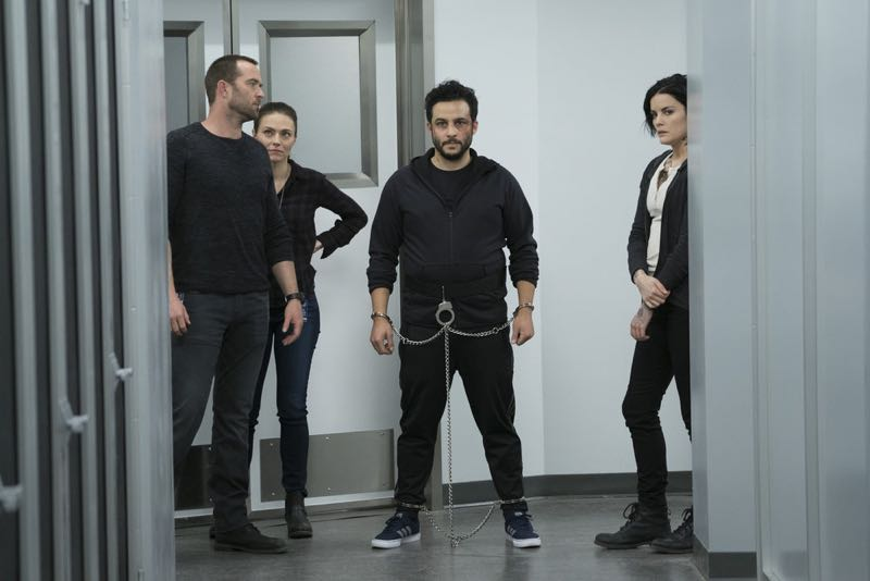 "BLINDSPOT -- ""One Begets Technique"" Episode 118 -- Pictured: (l-r) Sullivan Stapleton as Kurt Weller, Trieste Kelly Dunn as Allison Knight, Ennis Esmer as Rich Dotcom, Jaimie Alexander as Jane Doe -- (Photo by: Peter Kramer/NBC)"
