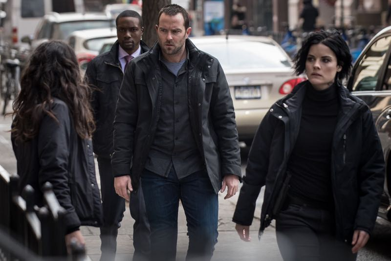 "BLINDSPOT -- ""Mans Telepathic Loyal Lookouts"" Episode 117 -- Pictured: (l-r) Rob Brown as Edgar Reed, Sullivan Stapleton as Kurt Weller, Jaimie Alexander as Jane Doe -- (Photo by: Jeff Neumann/NBC)"