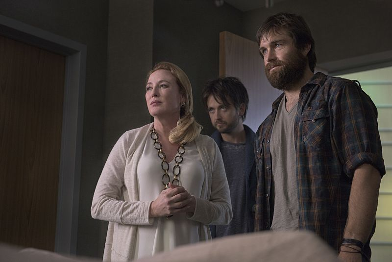 """""""Arrangement in Grey and Black"""" - A prominent Boston family reels in the wake of the chilling discovery that someone in their midst is linked to an infamous string of murders, on the series premiere of  """"American Gothic,"""" Tuesday, June 22 (10:00-11:00PM, ET/PT), on the CBS Television Network.  Juliet Rylance, Antony Starr, Virginia Madsen, Justin Chatwin, Megan Ketch, Elliot Knight, Stephanie Leonidas and Gabriel Bateman star.  Pictured: Madeline Hawthorne (Virginia Madsen), Cam Hawthorne (Justin Chatwin)  and Garrett Hawthorne (Antony Starr) visit Mitchell in the hospital.   Photo: Christos Kalohoridis/CBS ©2016 CBS Broadcasting, Inc. All Rights Reserved."""