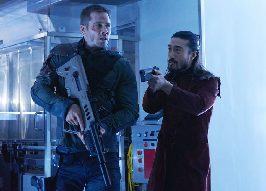 """KILLJOYS -- """"Dutch and the Real Girl"""" Episode 201 -- Pictured: (l-r) Luke Macfarlane as D'Avin, Sean Baek as Fancy Lee -- (Photo by: Steve Wilkie/Syfy/Killjoys II Productions Limited)"""