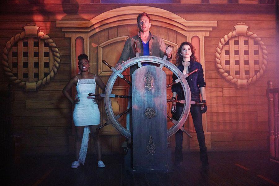SHARKNADO: THE 4TH AWAKENS -- Pictured: (l-r) Imani Hakim as Gabrielle, Ian Ziering as Fin Shepard, Masiela Lusha as Gemini -- (Photo by: Tyler Golden/Syfy)
