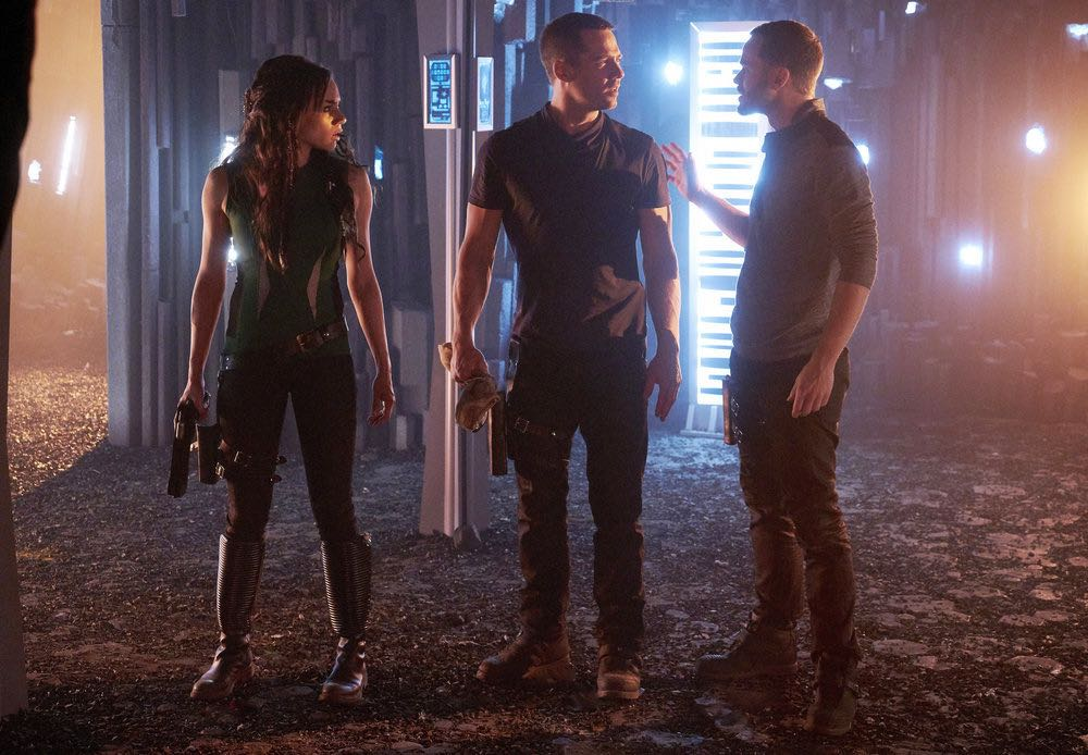"KILLJOYS -- ""I Love Lucy"" Episode 206 -- Pictured: (l-r) Hannah John-Kamen as Dutch, Luke Macfarlane as D'Avin, Aaron Ashmore as John -- (Photo by: Steve Wilkie/Syfy/Killjoys II Productions Limited)"