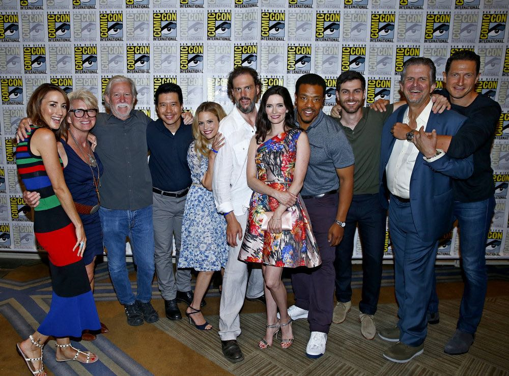 "COMIC-CON INTERNATIONAL: SAN DIEGO 2016 -- ""Grimm Panel and Press Room"" -- Pictured: (l-r) Bree Turner, Lynn Kouf, Producer; Jim Kouf, Executive Producer; Reggie Lee, Claire Coffee, Silas Weir Mitchell, Bitsie Tulloch, Russell Hornsby, David Giuntoli, David Greenwalt, Executive Producer; Sasha Roiz, Friday, July 22, 2016, from the Hilton Bayfront, San Diego, Calif. -- (Photo by: Mark Davis/NBC)"