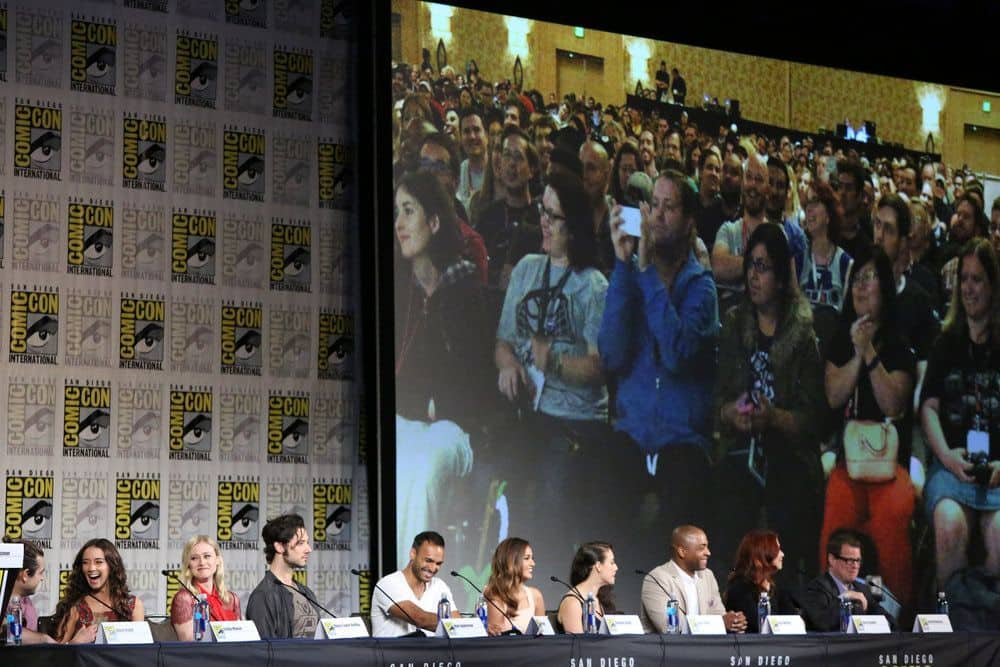 "COMIC-CON INTERNATIONAL: SAN DIEGO -- ""The Magicians Panel"" -- Pictured: (l-r) Jason Ralph, Stella Maeve, Olivia Taylor Dudley, Hale Appleman, Arjun Gupta, Summer Bishil, Jade Tailor, Rick Worthy, Executive Producer/Writer Sera Gamble, Executive Producer John McNamara  -- (Photo by: Evans Vestal Ward/Syfy)"