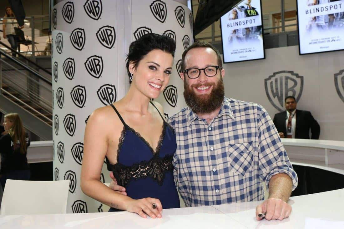 BLINDSPOT star Jaimie Alexander (left) and creator/executive producer Martin Gero enjoying their time at the Warner Bros. booth signing on Friday, July 22, at Comic-Con 2016.