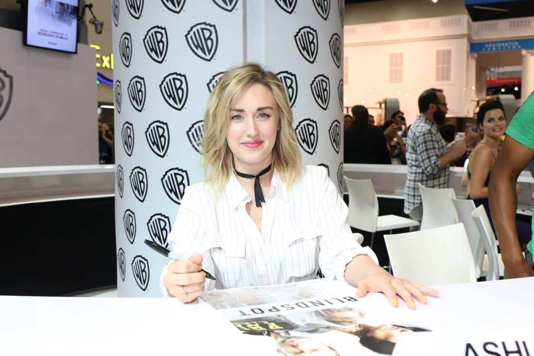BLINDSPOT star Ashley Johnson signing autographs for fans at the Warner Bros. booth during Comic-Con 2016 on Friday, July 22. #WBSDCC ( © 2016 WBEI. All Rights Reserved)