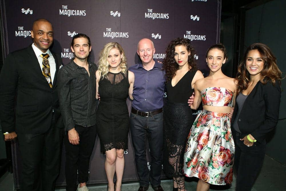 """COMIC-CON INTERNATIONAL: SAN DIEGO -- """"The Magicians Party at Hotel Solamar"""" -- Pictured: (l-r) Rick Worthy, Jason Ralph, Olivia Taylor Dudley, President SyFy/USA Chris McCumber, Jade Tailor, Stella Maeve, Summer Bishil -- (Photo by: Evans Vestal Ward/Syfy)"""