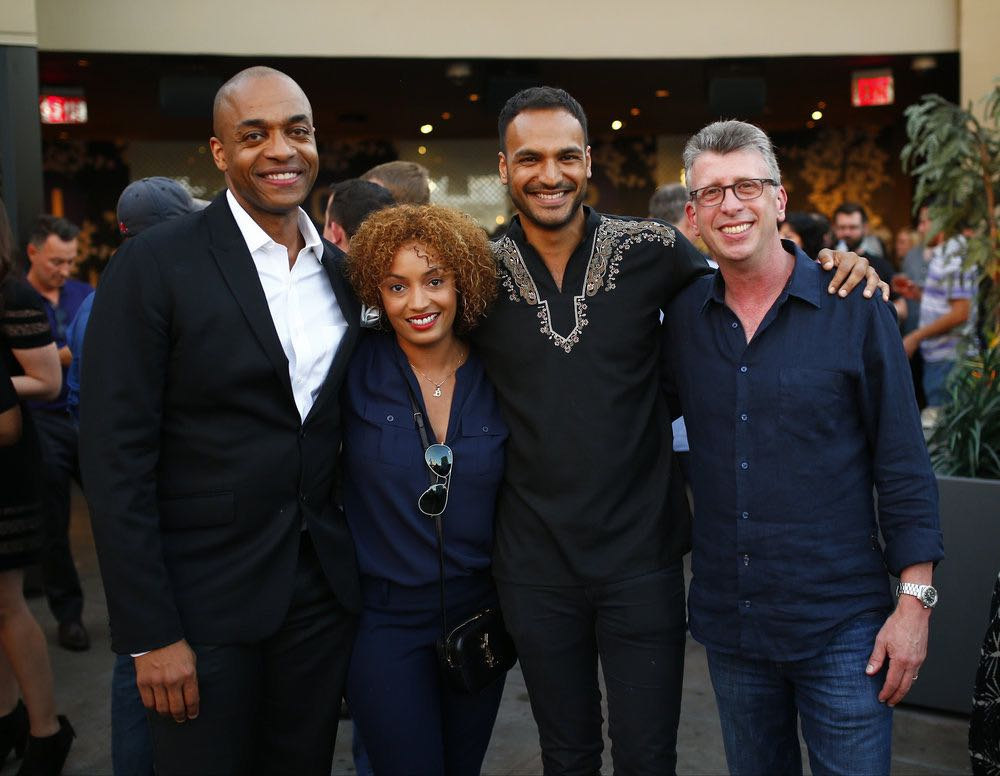"""COMIC-CON INTERNATIONAL: SAN DIEGO -- """"UCP Party"""" -- Pictured: (l-r) Rick Worthy; """"The Magicians""""; Danielle De Jesus, Director, Current Programming, UCP; Arjun Gupta, """"The Magicians""""; Richard Rothstein, EVP Current Programming, UCP -- (Photo by: Mark Davis/Universal Cable Productions)"""