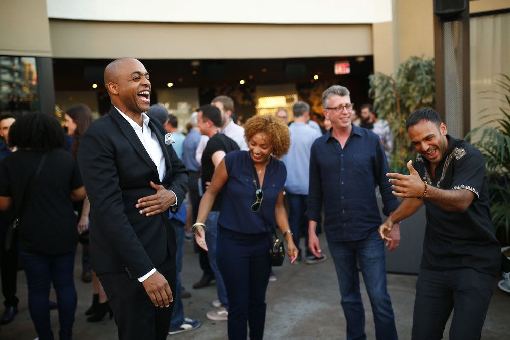 """COMIC-CON INTERNATIONAL: SAN DIEGO -- """"UCP Party"""" -- Pictured: (l-r) Rick Worthy; """"The Magicians""""; Danielle De Jesus, Director, Current Programming, UCP; Richard Rothstein, EVP Current Programming, UCP; Arjun Gupta, """"The Magicians"""" -- (Photo by: Mark Davis/Universal Cable Productions)"""
