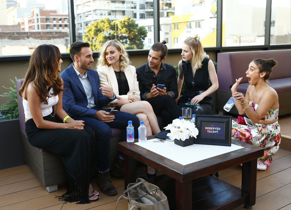 """COMIC-CON INTERNATIONAL: SAN DIEGO -- """"UCP Party"""" -- Pictured: (l-r) Summer Bishil, """"The Magicians""""; Party Guest; Olivia Taylor Dudley, Jason Ralph, """"The Magicians""""; Rachel Brosnahan; Stella Maeve, """"The Magicians"""" -- (Photo by: Mark Davis/Universal Cable Productions)"""