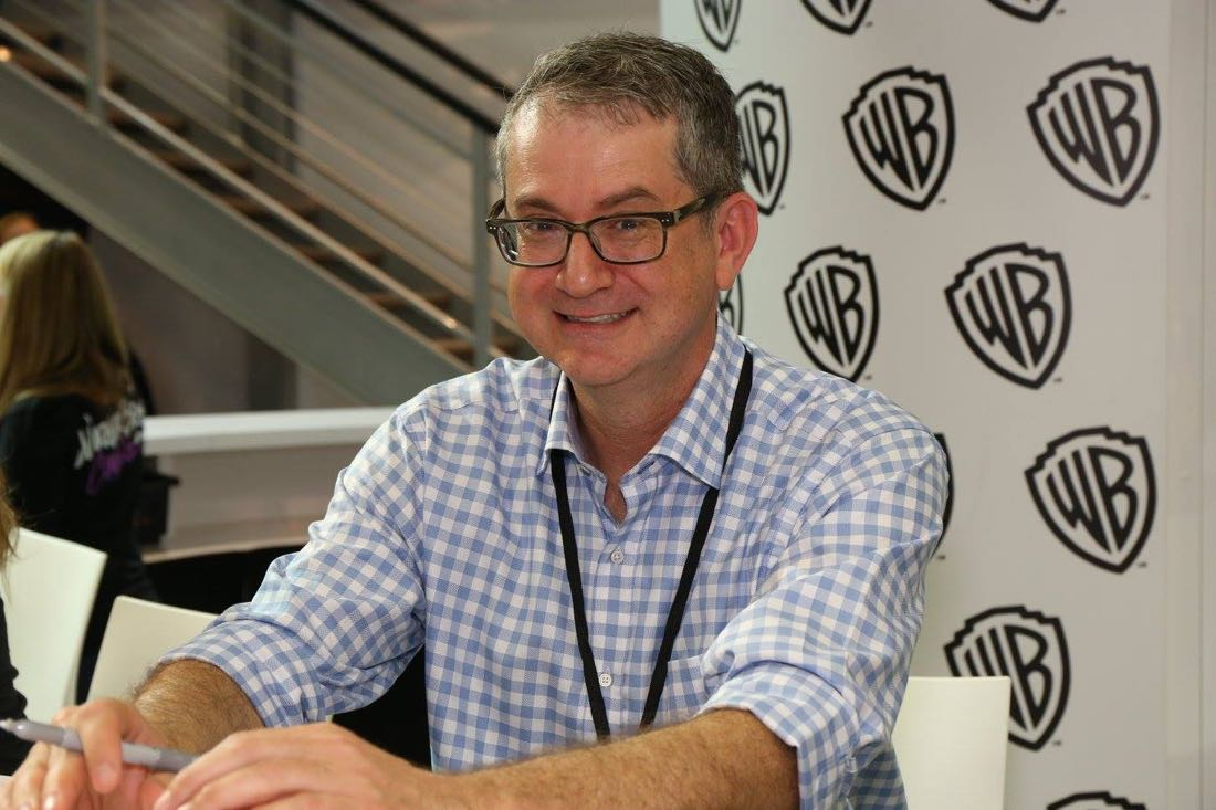 PEOPLE OF EARTH executive producer Greg Daniels signing for fans in the Warner Bros. booth on Friday, July 22, at Comic-Con 2016. #WBSDCC (© 2016 WBEI. All Rights Reserved.)