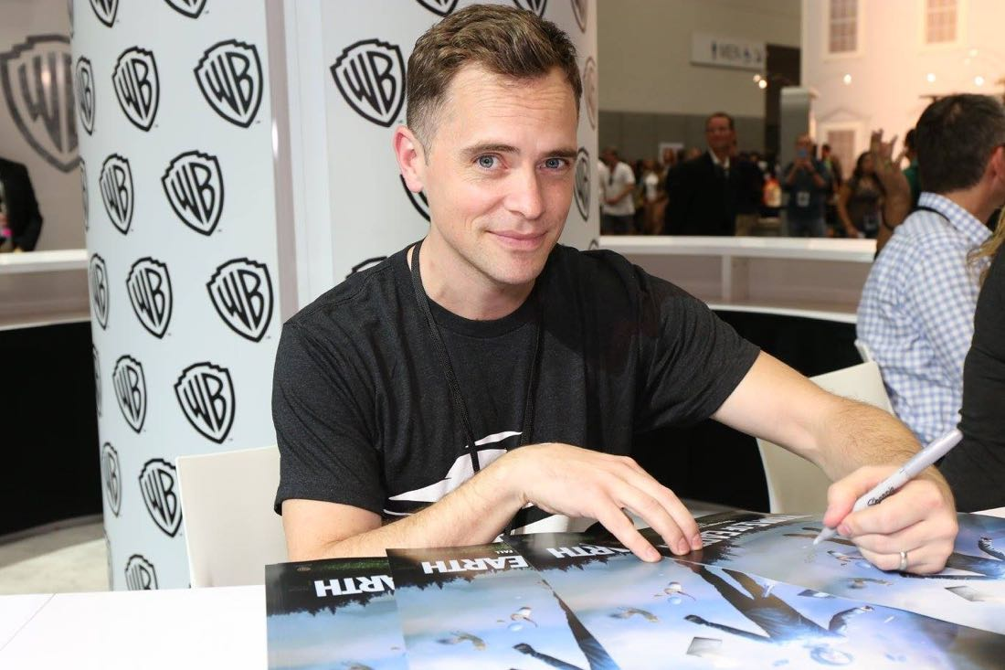 PEOPLE OF EARTH executive producer David Jenkins signing for fans in the Warner Bros. booth on Friday, July 22, at Comic-Con 2016. #WBSDCC (© 2016 WBEI. All Rights Reserved.)