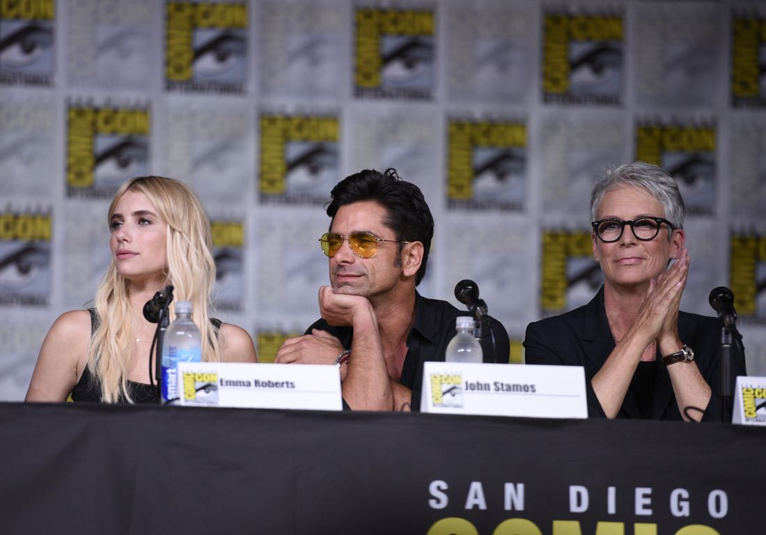 FOX FANFARE AT SAN DIEGO COMIC-CON © 2016: (L-R) SCREAM QUEENS cast members Emma Roberts, John Stamos and Jamie Lee Curtis during the SCREAM QUEENS panel on Friday, July 22 at the FOX FANFARE AT SAN DIEGO COMIC-CON © 2016. CR: Alan Hess/FOX © 2016 FOX BROADCASTING
