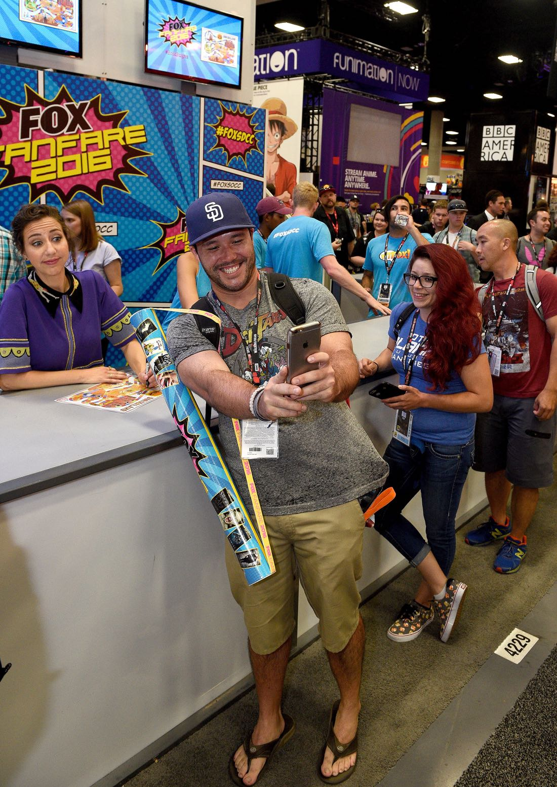 FOX FANFARE AT SAN DIEGO COMIC-CON © 2016: L-R: BOB'S BURGERS cast member Kristen Schaal  and a fan during BOB'S BURGERS booth signing on Friday, July 22 at the FOX FANFARE AT SAN DIEGO COMIC-CON © 2016. CR: Alan Hess/FOX © 2016 FOX BROADCASTING