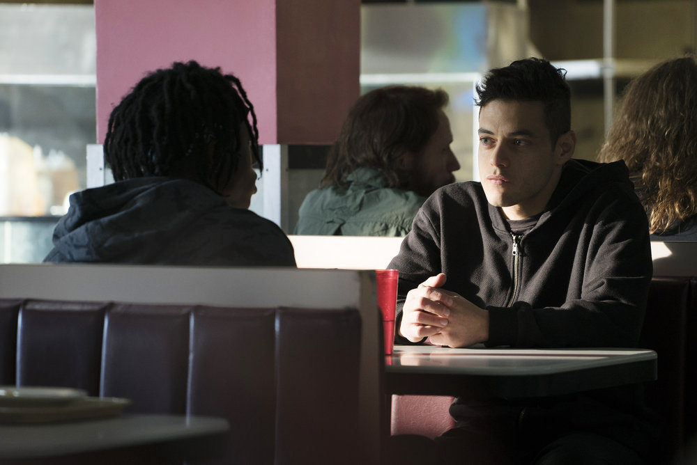 "MR. ROBOT -- ""eps2.0_unmasking.zip"" Episode 201 -- Pictured: (l-r) Joey Bada$$ as Leon, Rami Malek as Eliot Alderson -- (Photo by: Peter Kramer/USA Network)"