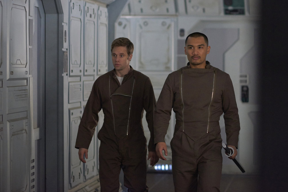 "DARK MATTER -- ""Kill Them All"" Episode 202 -- Pictured: (l-r) Shaun Sipos as Devon, Alex Mallari, Jr. as Four -- (Photo by: Russ Martin/Prodigy Pictures/Syfy)"