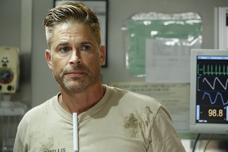 """""""Second Year"""" -- Colonel Ethan Willis (Rob Lowe) joins the team at Angels Memorial from the Department of Defense and takes Dr. Mike Leighton on a harrowing helicopter ride to save shark bite victims in Malibu, on the second season premiere of CODE BLACK, Wednesday, Sept. 28 (10:00-11:00PM, ET/PT), on the CBS Television Network.  Pictured: Rob Lowe (Col. Ethan Willis)  Photo: Cliff Lipson/CBS  ©2016 CBS Broadcasting, Inc. All Rights Reserved"""