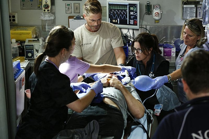 """""""Second Year"""" -- Colonel Ethan Willis (Rob Lowe) joins the team at Angels Memorial from the Department of Defense and takes Dr. Mike Leighton on a harrowing helicopter ride to save shark bite victims in Malibu, on the second season premiere of CODE BLACK, Wednesday, Sept. 28 (10:00-11:00PM, ET/PT), on the CBS Television Network.  Pictured: Rob Lowe (Col. Ethan Willis), Marcia Gay Harden (Dr. Leanne Rorish)  Photo: Cliff Lipson/CBS ©2016 CBS Broadcasting, Inc. All Rights Reserved"""