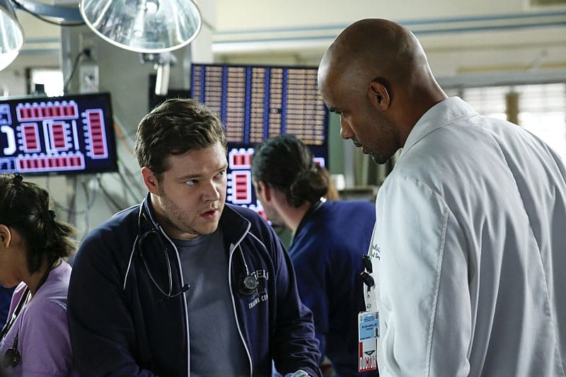 """""""Second Year"""" -- Colonel Ethan Willis (Rob Lowe) joins the team at Angels Memorial from the Department of Defense and takes Dr. Mike Leighton on a harrowing helicopter ride to save shark bite victims in Malibu, on the second season premiere of CODE BLACK, Wednesday, Sept. 28 (10:00-11:00PM, ET/PT), on the CBS Television Network.  Pictured: Harry Ford (Dr. Angus Leighton) and Boris Kodjoe (Dr. Will Campbell)  Photo: Cliff Lipson/CBS ©2016 CBS Broadcasting, Inc. All Rights Reserved"""