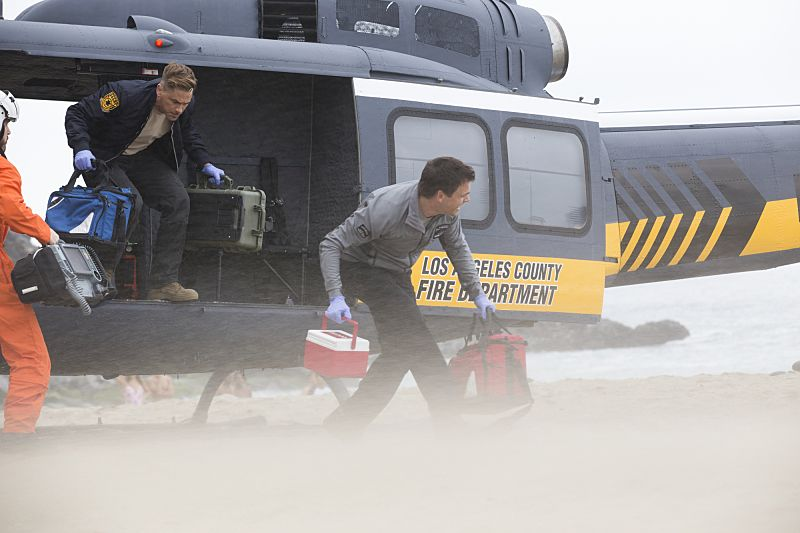 """""""Second Year"""" -- Colonel Ethan Willis (Rob Lowe) joins the team at Angels Memorial from the Department of Defense and takes Dr. Mike Leighton on a harrowing helicopter ride to save shark bite victims in Malibu, on the second season premiere of CODE BLACK, Wednesday, Sept. 28 (10:00-11:00PM, ET/PT), on the CBS Television Network.   Pictured: Rob Lowe (Col. Ethan Willis), Tommy Dewey (Dr. Mike Leighton)  Photo: Paul Sarkis/CBS ©2016 CBS Broadcasting, Inc. All Rights Reserved"""