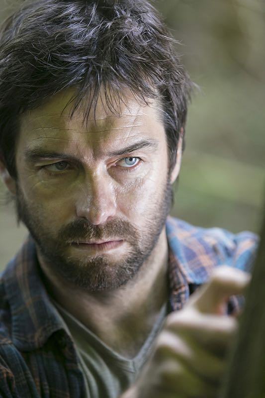 """The Oxbow"" - Key Hawthorne family secrets are revealed when Garrett is forced to reflect on his 14 years of solitude in the woods.  Also, Alison turns the screws on a local reporter, with shocking results, on AMERICAN GOTHIC, Wednesday, August 17 (10:00-11:00 PM, ET/PT), on the CBS Television Network. Pictured: Antony Starr as Garrett Hawthorne.  Photo:  Iden Ford/CBS ©2016 CBS Broadcasting, Inc. All Rights Reserved."