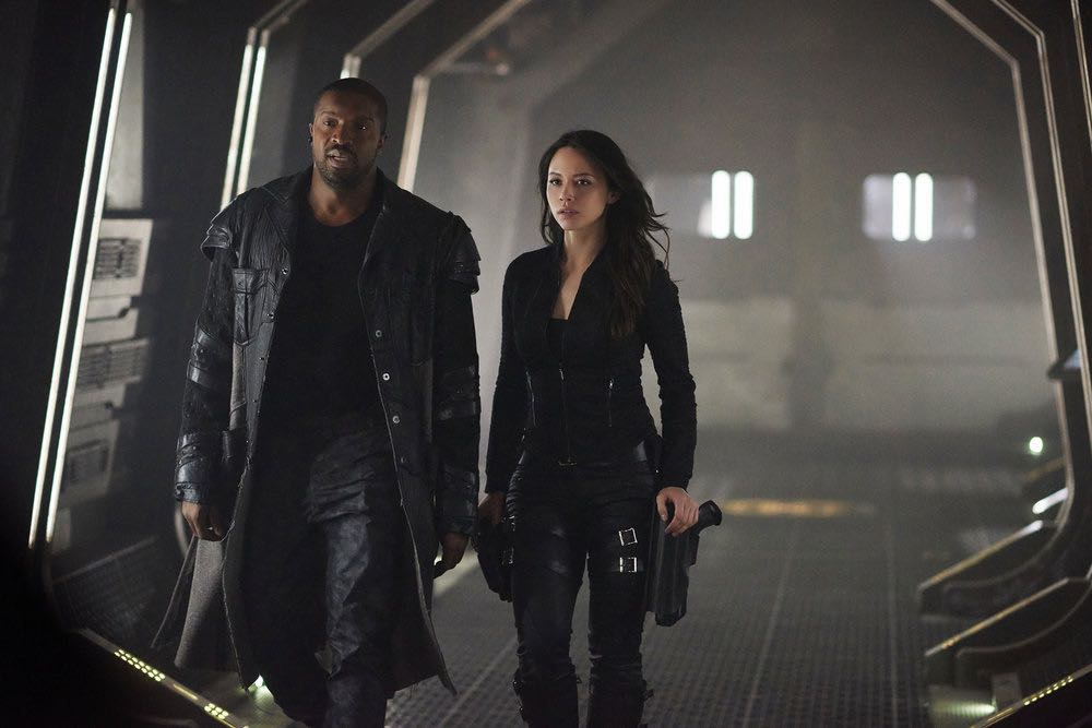 "DARK MATTER -- ""She's One of Them Now"" Episode 207 -- Pictured:  (l-r) Roger Cross as Six, Melissa O'Neil as Two -- (Photo by: Russ Martin/Prodigy Pictures/Syfy)"