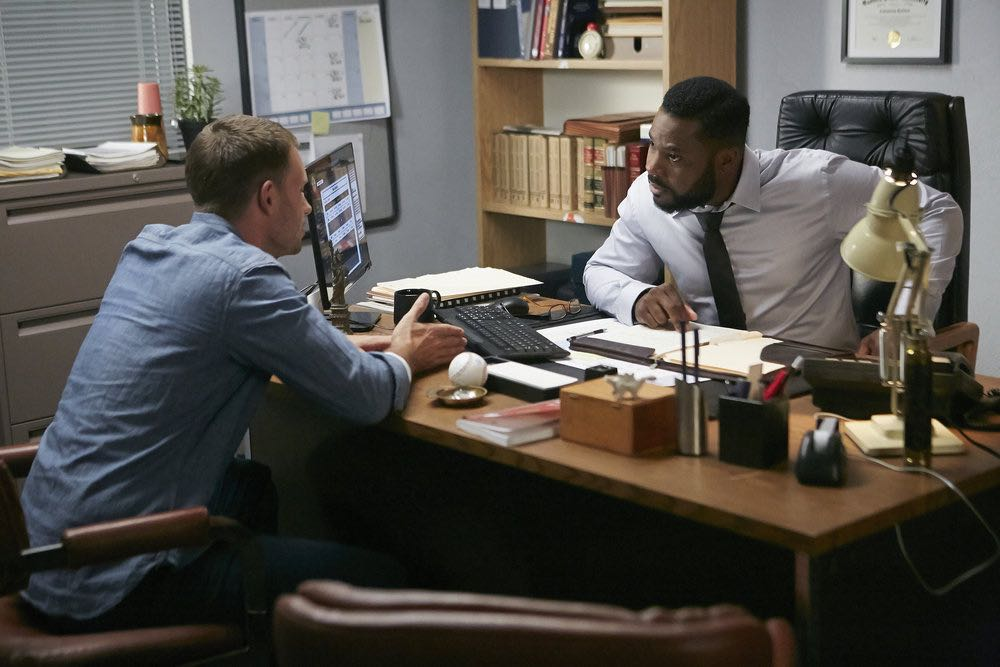 "SUITS -- ""Trust"" Episode 605 -- Pictured: (l-r) Patrick J. Adams as Michael Ross, Malcolm-Jamal Warner as Julius Rowe -- (Photo by: Ian Watson/USA Network)"