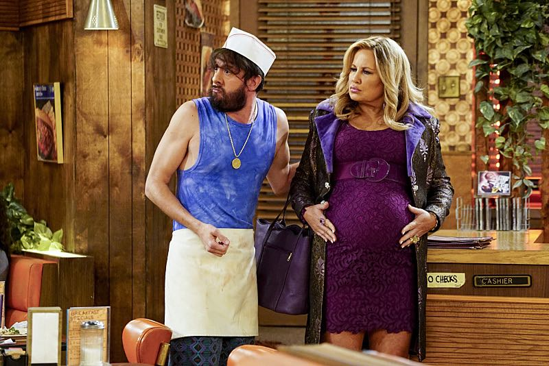 """And The Two Openings: Part One"" -- Pictured: Oleg (Jonathan Kite) and Sophie (Jennifer Coolidge). As Max and Caroline, now part owners of the diner, put the finishing touches on their newly converted Dessert Bar, Max deals with the aftermath of her recent breakup with Randy, and Sophie and Oleg prepare for the birth of their baby, on the sixth season premiere of 2 BROKE GIRLS, Monday, Oct. 10 (9:00-9:30 PM, ET/PT) on the CBS Television Network. Photo: Sonja Flemming/CBS ©2016 CBS Broadcasting, Inc. All Rights Reserved"