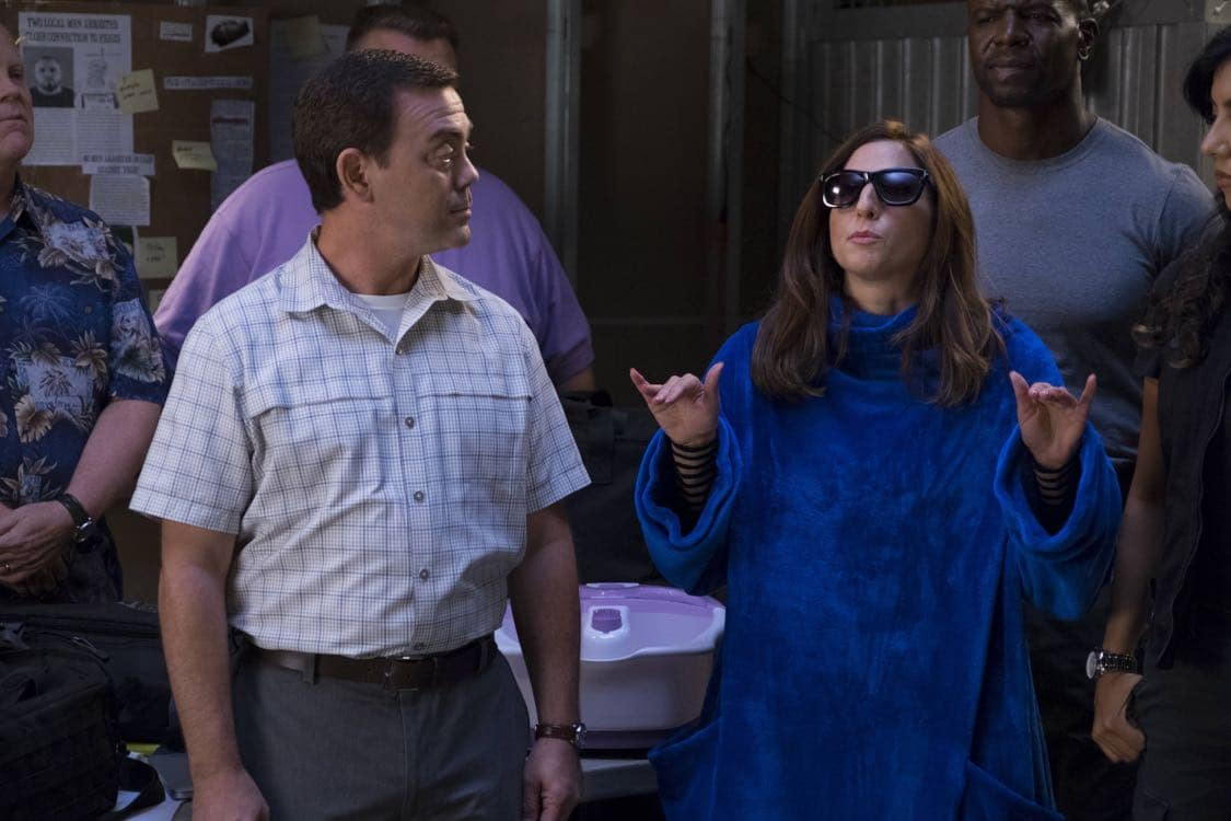 "BROOKLYN NINE-NINE: L-R: Chelsea Peretti and Joe Lo Truglio in the ""Coral Palms Pt.3"" episode of BROOKLYN NINE-NINE airing Tuesday, Oct. 4 (8:00-8:30 PM ET/PT) on FOX. CR: John P Fleenor/FOX"