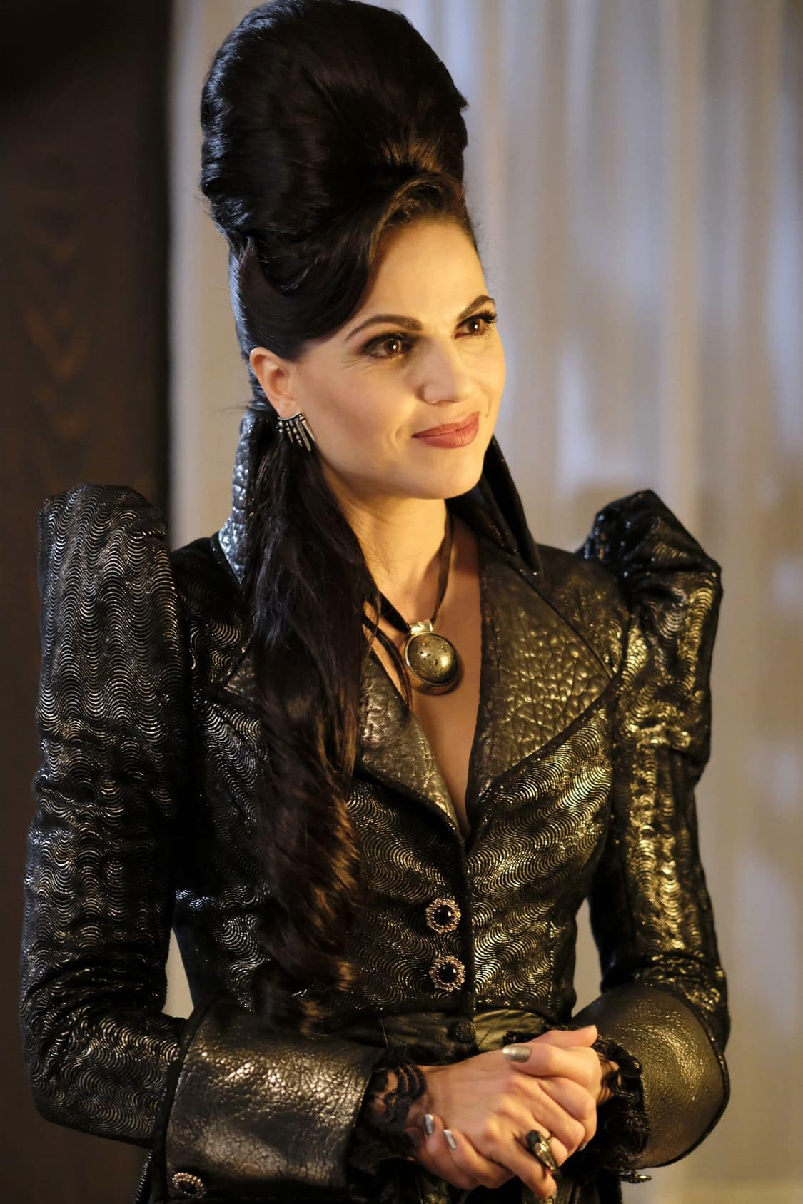 """ONCE UPON A TIME - """"A Bitter Draught"""" - When a mysterious man from the Land of Untold Stories, who has a past with the Evil Queen, arrives in Storybrooke, David and Snow work together with Regina to neutralize the threat. Belle seeks Hook's help finding a safe place to hide away from her husband, Mr. Gold. The Evil Queen continues to try to win Zelena over to her side, while Emma resumes her therapy sessions with Archie and shares her terrifying vision of the future, on """"Once Upon a Time,"""" SUNDAY, OCTOBER 2 (8:00-9:00 p.m. EDT), on the ABC Television Network. (ABC/Eike Schroter) LANA PARRILLA"""