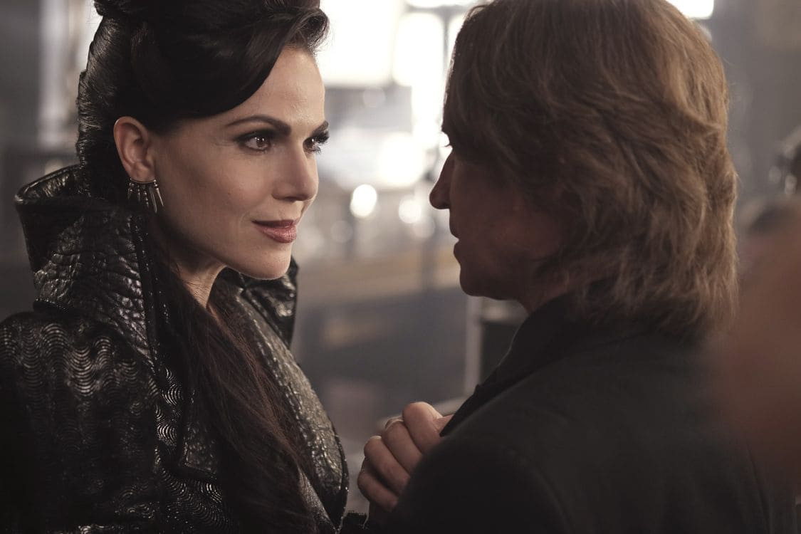 """ONCE UPON A TIME - """"A Bitter Draught"""" - When a mysterious man from the Land of Untold Stories, who has a past with the Evil Queen, arrives in Storybrooke, David and Snow work together with Regina to neutralize the threat. Belle seeks Hook's help finding a safe place to hide away from her husband, Mr. Gold. The Evil Queen continues to try to win Zelena over to her side, while Emma resumes her therapy sessions with Archie and shares her terrifying vision of the future, on """"Once Upon a Time,"""" SUNDAY, OCTOBER 2 (8:00-9:00 p.m. EDT), on the ABC Television Network. (ABC/Eike Schroter) LANA PARRILLA, ROBERT CARLYLE"""