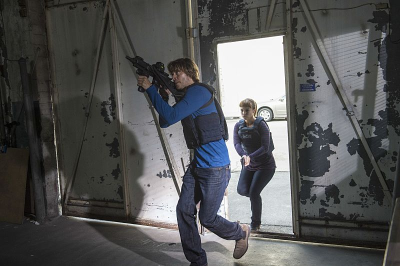 """""""Black Market"""" -- Pictured: Eric Christian Olsen (LAPD Liaison Marty Deeks) and Renée Felice Smith (Intelligence Analyst Nell Jones). After a Homeland Security agent is poisoned by a notorious Triad assassin, NCIS uncovers a warehouse of counterfeit purses and a money trail to stolen government funds. Also, Nell joins the team in the field, on NCIS: LOS ANGELES, Sunday, Oct. 16 (8:00-9:00 PM, ET/PT), on the CBS Television Network. Photo: Neil Jacobs/CBS ©2016 CBS Broadcasting, Inc. All Rights Reserved."""