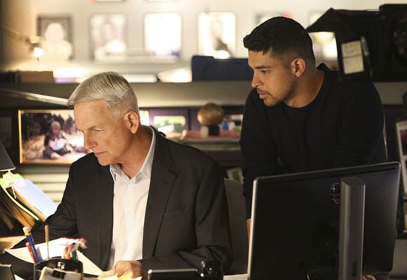 """""""Being Bad"""" -- NCIS uncovers a bomb plot and a long-running theft ring while investigating a death at a Quantico reunion. Also Torres and Quinn adjust to life on Gibbs' team, including new seating arrangements in the squad room, on NCIS, Tuesday, Sept. 27 (8:00-9:00, ET/PT), on the CBS Television Network. Pictured: Mark Harmon, Wilmer Valderrama. Photo: Patrick McElhenney/CBS ©2016 CBS Broadcasting, Inc. All Rights Reserved"""