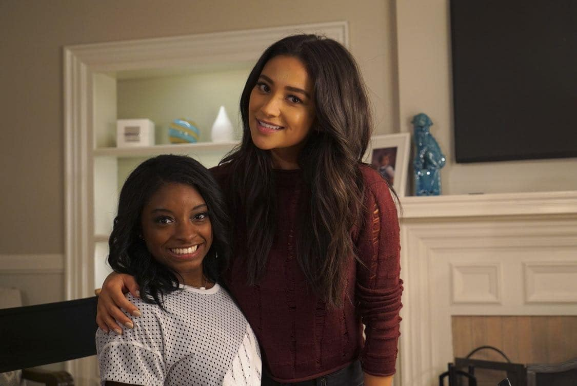 "PRETTY LITTLE LIARS - USA Olympic gold medal gymnast Simone Biles visits the set of 'Pretty Little Liars.'"" (Freeform/Byron Cohen) SIMONE BILES, SHAY MITCHELL"