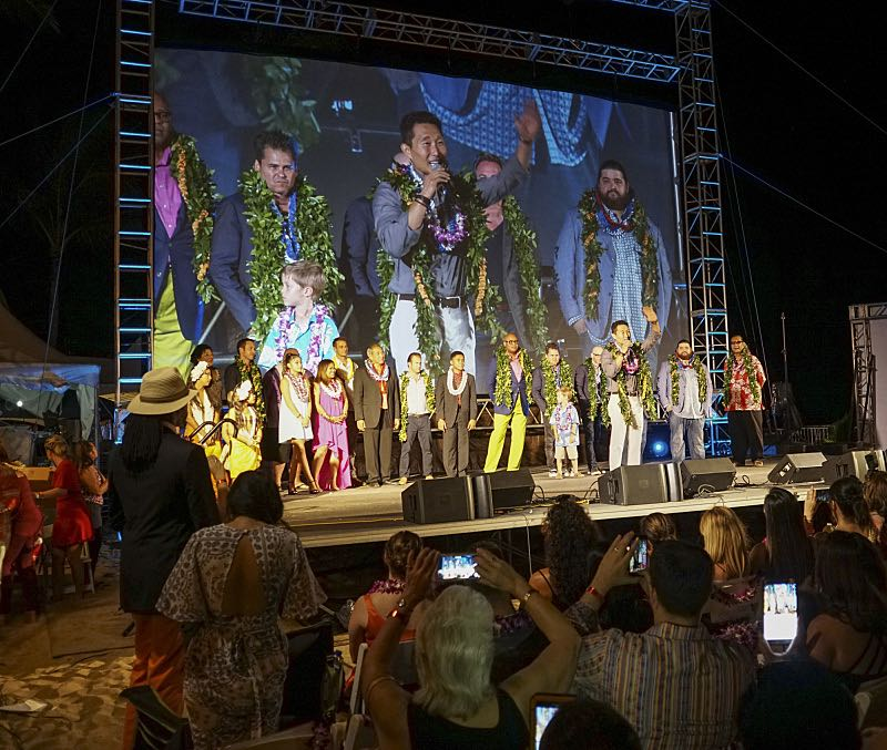 The cast of Hawaii Five-0 on staget at the seventh annual Sunset on the Beach event, where thousands of Oahu residents and visitors gathered in Waikiki to watch the season seven premiere of Hawaii Five-0, titled Makaukau 'oe e pa 'ani, on Friday, Sept. 23, 2016, in Honolulu. Photo: Norman Shapiro/CBS © 2016 CBS Broadcasting, Inc. All Rights Reserved